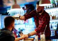 Man falling off his stool in a bar Jokes Times